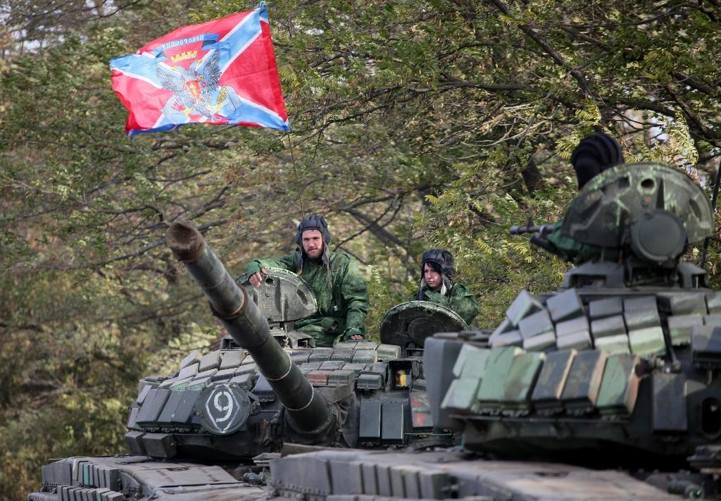 Pro-Russian separatists soldiers withdraw their tanks from position near town of Novoazovsk in Donetsk region on October 21, 2015