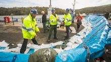 Flood barriers erected on the Cornish coast as Britain prepares for Storm Brian