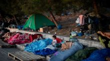 Fed-up Lesbos islanders, migrants stuck waiting for Europe to decide