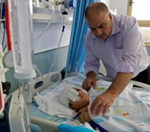Family of Palestinian boy wounded in head wants answers from Israel
