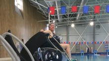 Poolside lift helps people with mobility problems enjoy a dip on their own