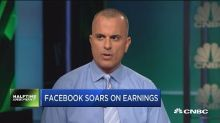 Facebook tops earnings despite privacy scandal