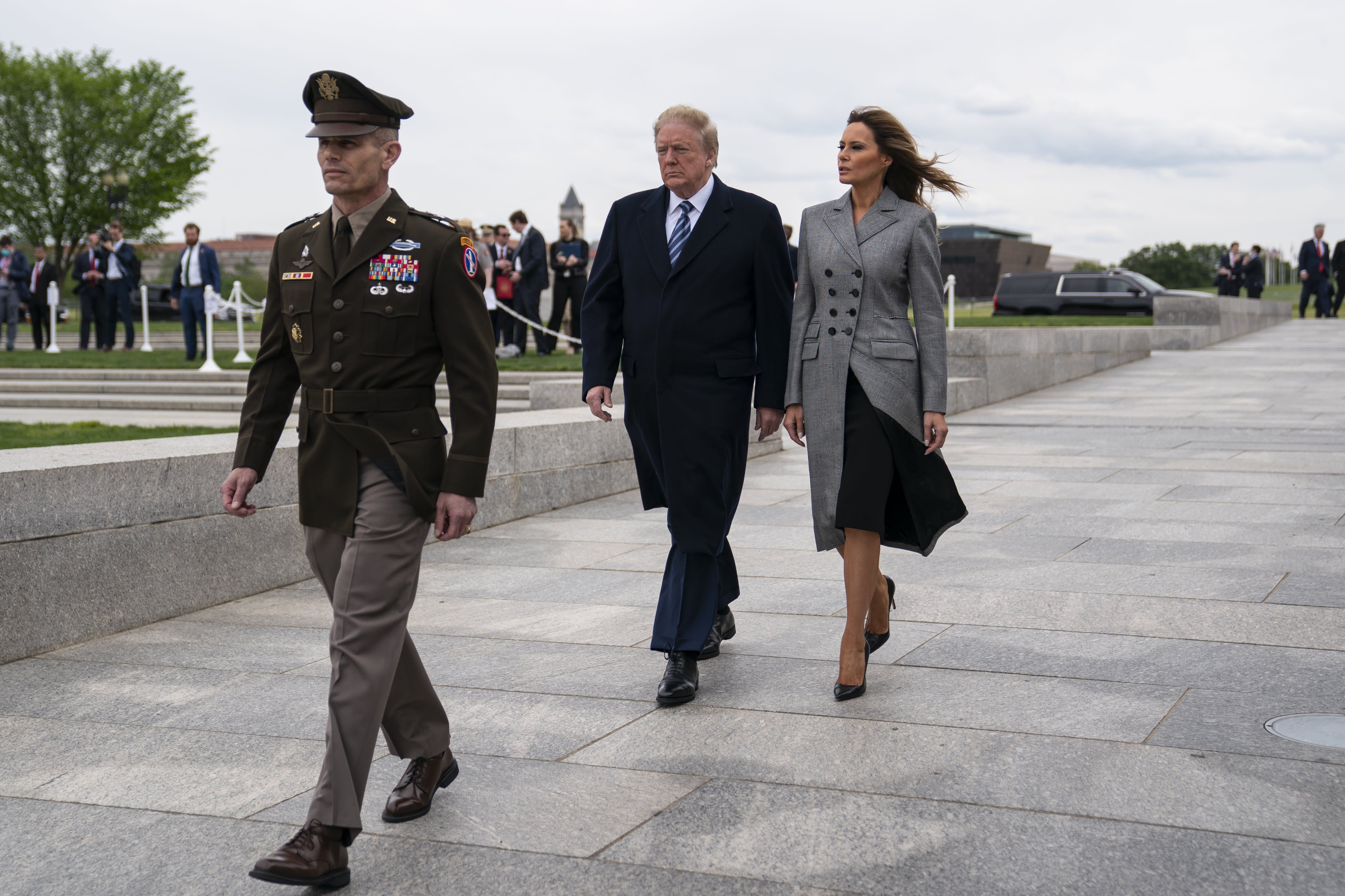 President Donald Trump and first lady Melania Trump arrive to participate in a wreath laying ceremony at the World War II Memorial to commemorate the 75th anniversary of Victory in Europe Day, Friday, May 8, 2020, in Washington. (AP Photo/Evan Vucci)