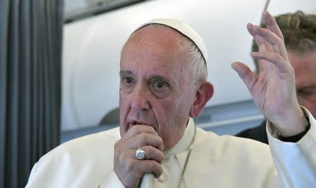 Pope Francis speaks to reporters as he flies back to Rome following the visit at the Holy Shrine of Fatima