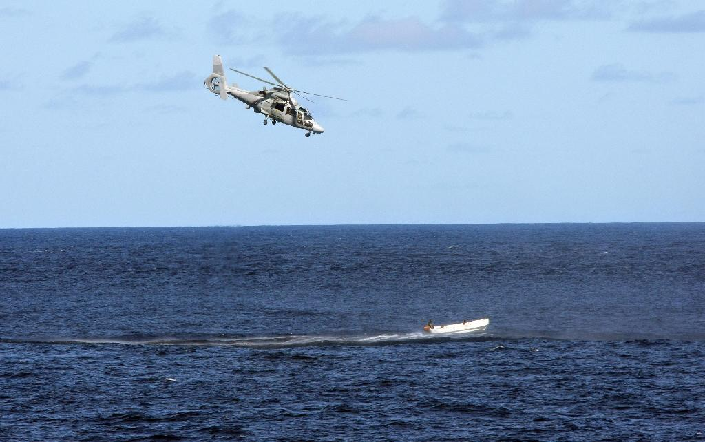 A French Navy helicopter chases a boat carrying suspected Somali pirates as part of an anti-piracy naval mission on May 3, 2009 (AFP Photo/Pierre Verdy)