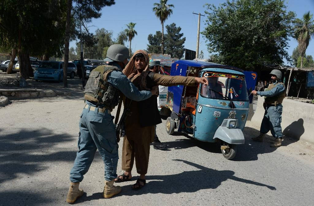 An Afghan police search vehicles in Jalalabad, on April 29, 2016, after an Australian aid worker, Katherine Jane Wilson, was kidnapped by armed men (AFP Photo/Noorullah Shirzada)
