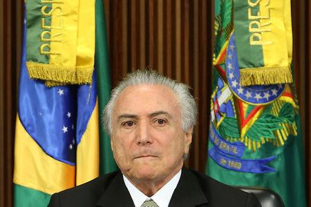 Brazil's interim President Michel Temer reacts during a meeting of the presentation of economic measures, at the Planalto Palace in Brasilia