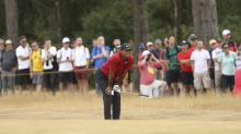 The Latest: Woods drops out of lead at British Open