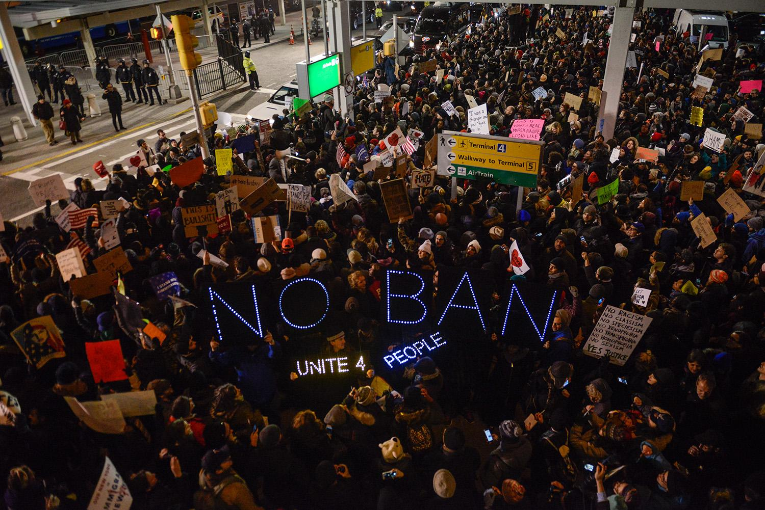 <p>Protestors rally during a demonstration against the Muslim immigration ban at John F. Kennedy International Airport on January 28, 2017 in New York City. (Photo: Stephanie Keith/Getty Images) </p>