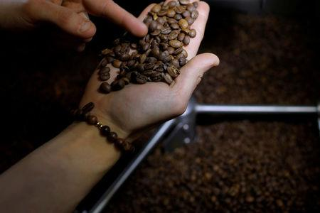 FILE PHOTO: Sandra Dias checks coffee beans as they are roasted at Redeye Coffee Roasters in Hull, Massachusetts, U.S., May 2, 2017. REUTERS/Brian Snyder/File Photo