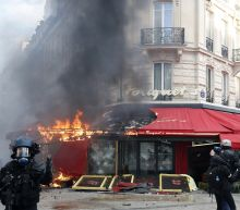 The Latest: French protesters slam Macron's 'empty words'