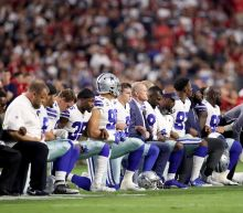 Cowboys and Cardinals show unity during US anthem