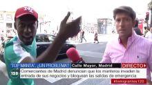 """Tenso enfrentamiento en directo entre un mantero y un reportero de Telemadrid: """"¡Tenemos que comer!"""""""