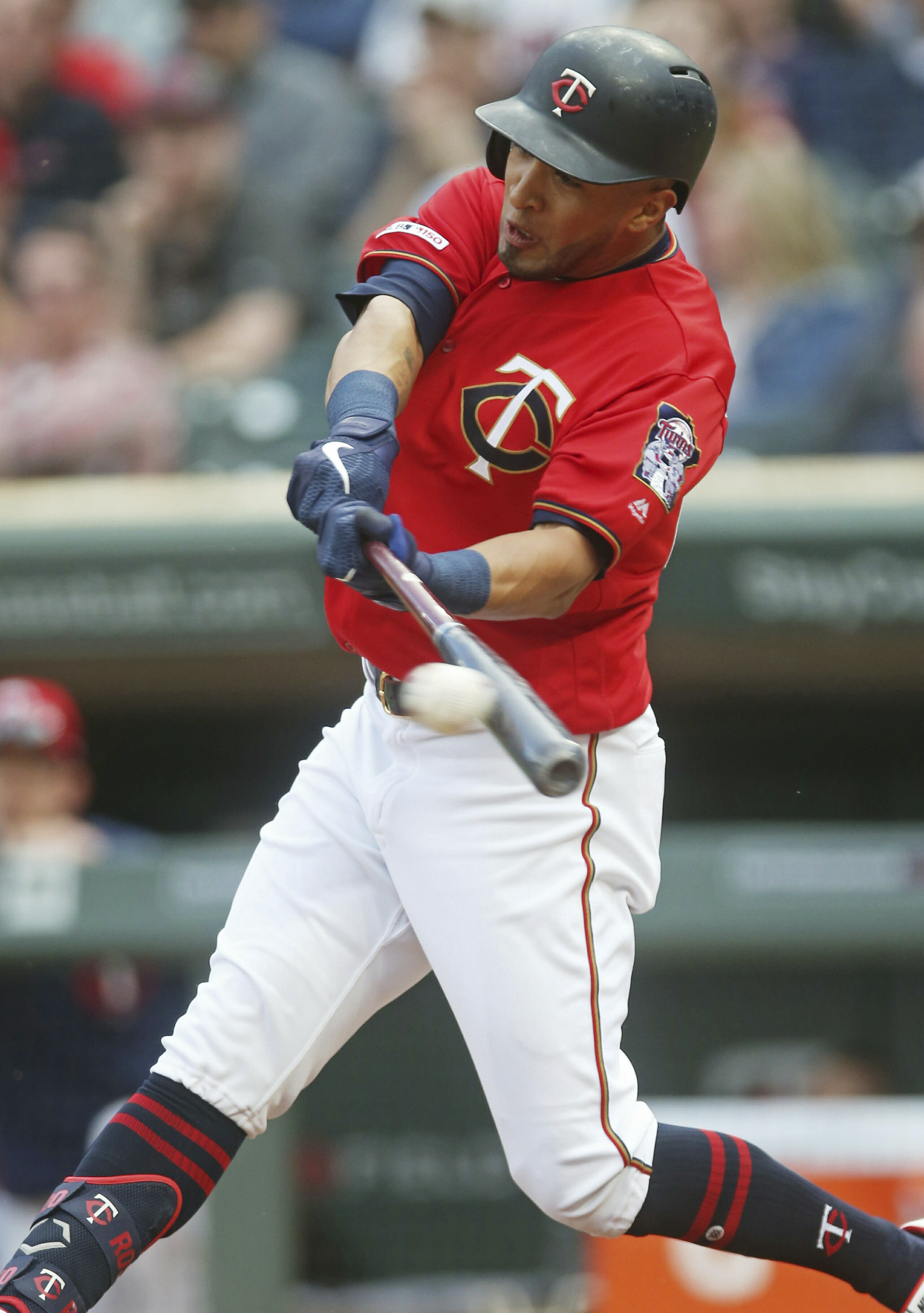 Minnesota Twins' Eddie Rosario hits an RBI single off Los Angeles Angels pitcher Cam Bedrosian in the first inning of a baseball game Tuesday, May 14, 2019, in Minneapolis. (AP Photo/Jim Mone)