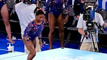 US women's gymnastics team makes missteps, finishes second in qualifying for team finals