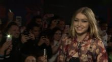 Gigi Hadid ruled the runway in a sports bra and see-through blouse