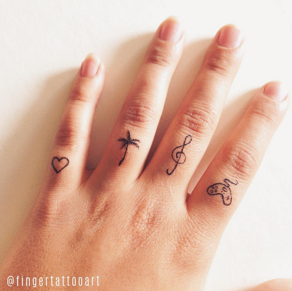 861a4df7e 25 Tiny Finger Tattoos You'll Want to Get Right Now