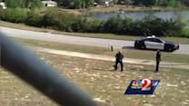 Raw video: Deputy wrestles alligator outside school