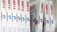 Domino's shares up as earnings overshadow slower growth