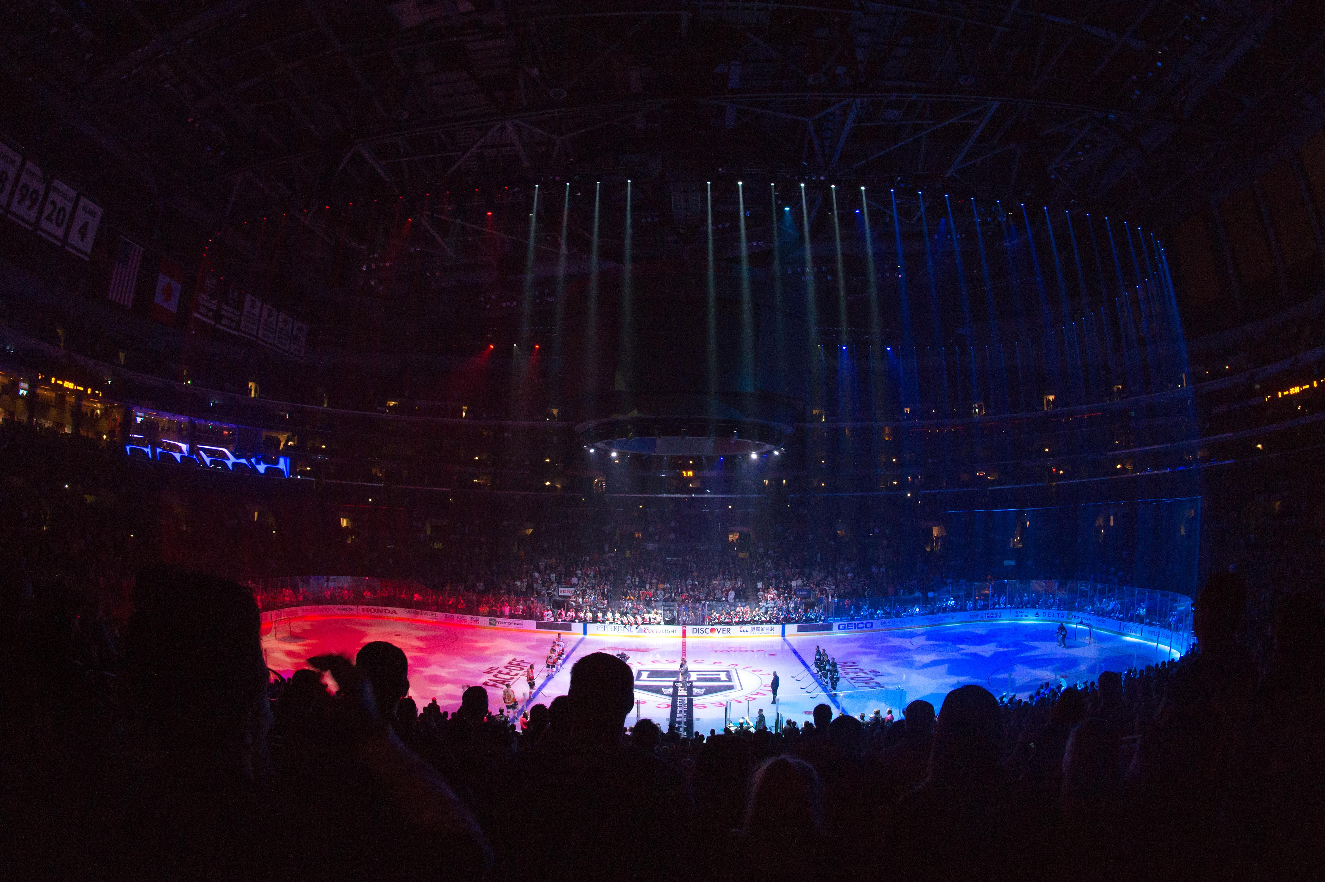 <p>A moment of silence is observed for Kings employee Christiana Duarte and other victims of the mass shooting in Las Vegas before a game between the Philadelphia Flyers and the Los Angeles Kings at STAPLES Center on Oct. 5, 2017 in Los Angeles, Calif. (Photo: Aaron Poole/NHLI via Getty Images) </p>