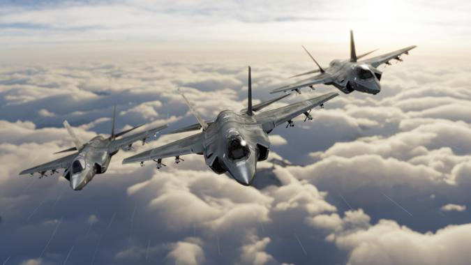 Three F-35 fighter jets flying over clouds in vic formation 3d render