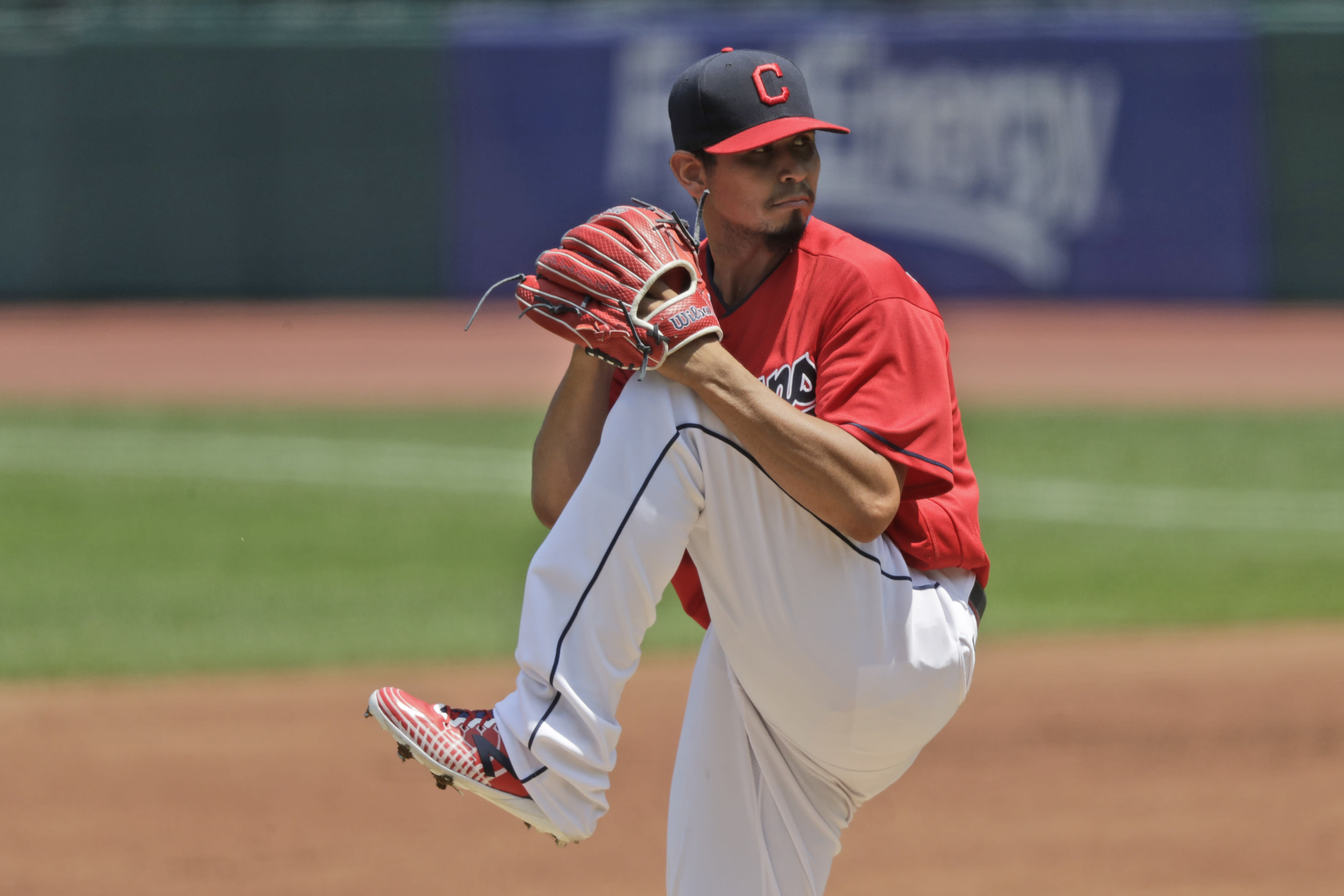 Cleveland Indians starting pitcher Carlos Carrasco winds up in the first inning in a baseball game against the Kansas City Royals, Sunday, July 26, 2020, in Cleveland. (AP Photo/Tony Dejak)
