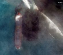 A stranded tanker carrying 4,000 tons of fuel has breached and is leaking oil into the pristine, azure waters of the Indian Ocean