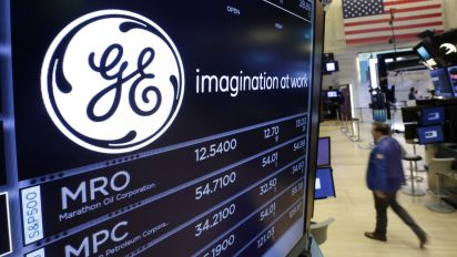 GE slashes profit forecast, shares tumble