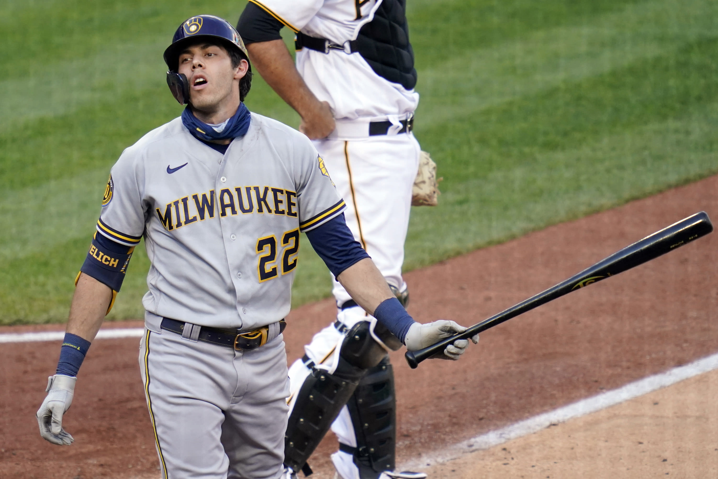 Milwaukee Brewers' Christian Yelich (22) reacts after striking out against the Pittsburgh Pirates in the fifth inning of a baseball game, Saturday, Aug. 22, 2020, in Pittsburgh. (AP Photo/Keith Srakocic)