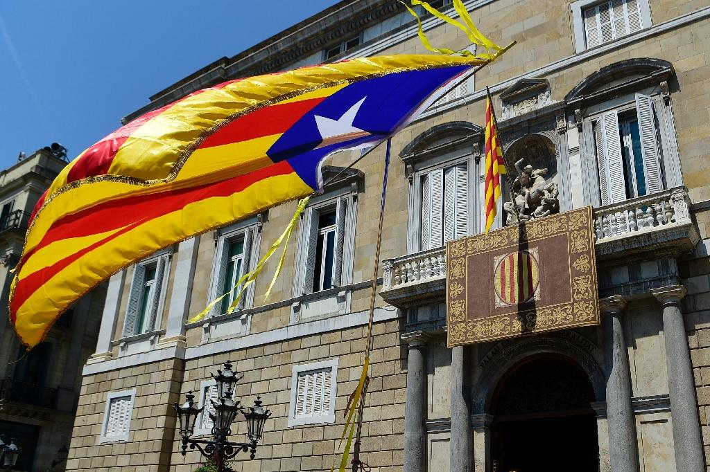 A Catalan pro-independence flag flies in front of the government building in Barcelona, in a region which has been under direct rule by Madrid since October following a failed independence bid
