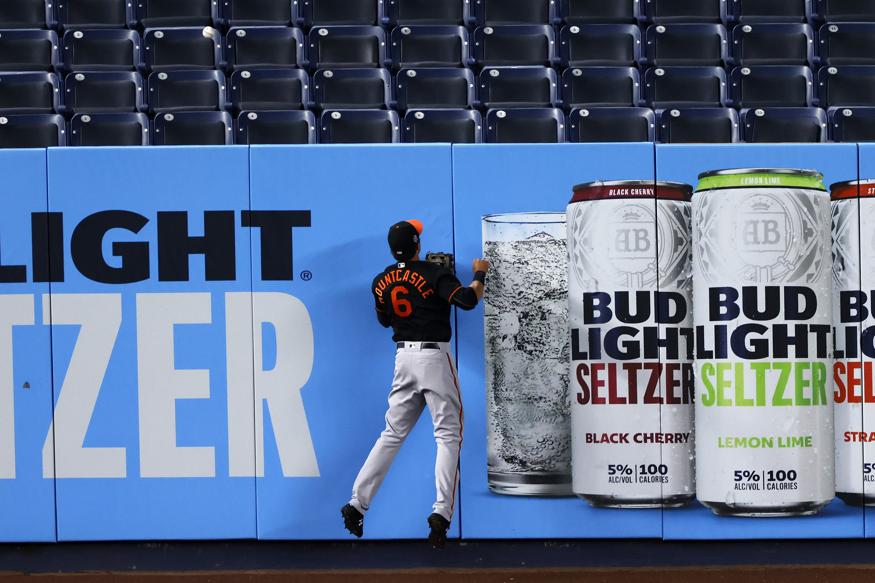 Baltimore Orioles left fielder Ryan Mountcastle can only watch as a three-run home run by New York Yankees' Luke Voit falls into the seats during the fifth inning of the second baseball game of a doubleheader Friday, Sept. 11, 2020, in New York. (AP Photo/Adam Hunger)