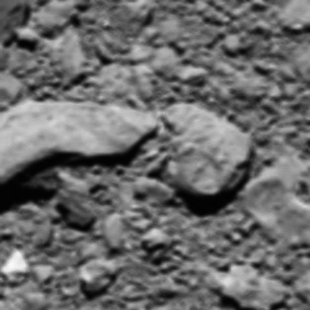 This handout image released by the European Space Agency (ESA) on September 28, 2017 shows the reconstructed last image from Rosetta before it shut down on the surface of the comet last year