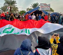 Iraq mob lynches 16-year-old after he attacked and killed anti-government protesters