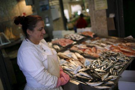 Sonia Silva, 41, waits for customers at her fish stall in Almada's market, near Lisbon, Portugal November 18, 2015. REUTERS/Rafael Marchante