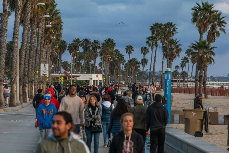 Californians are under orders to stay home, but crowds continue to flock to the state's beaches