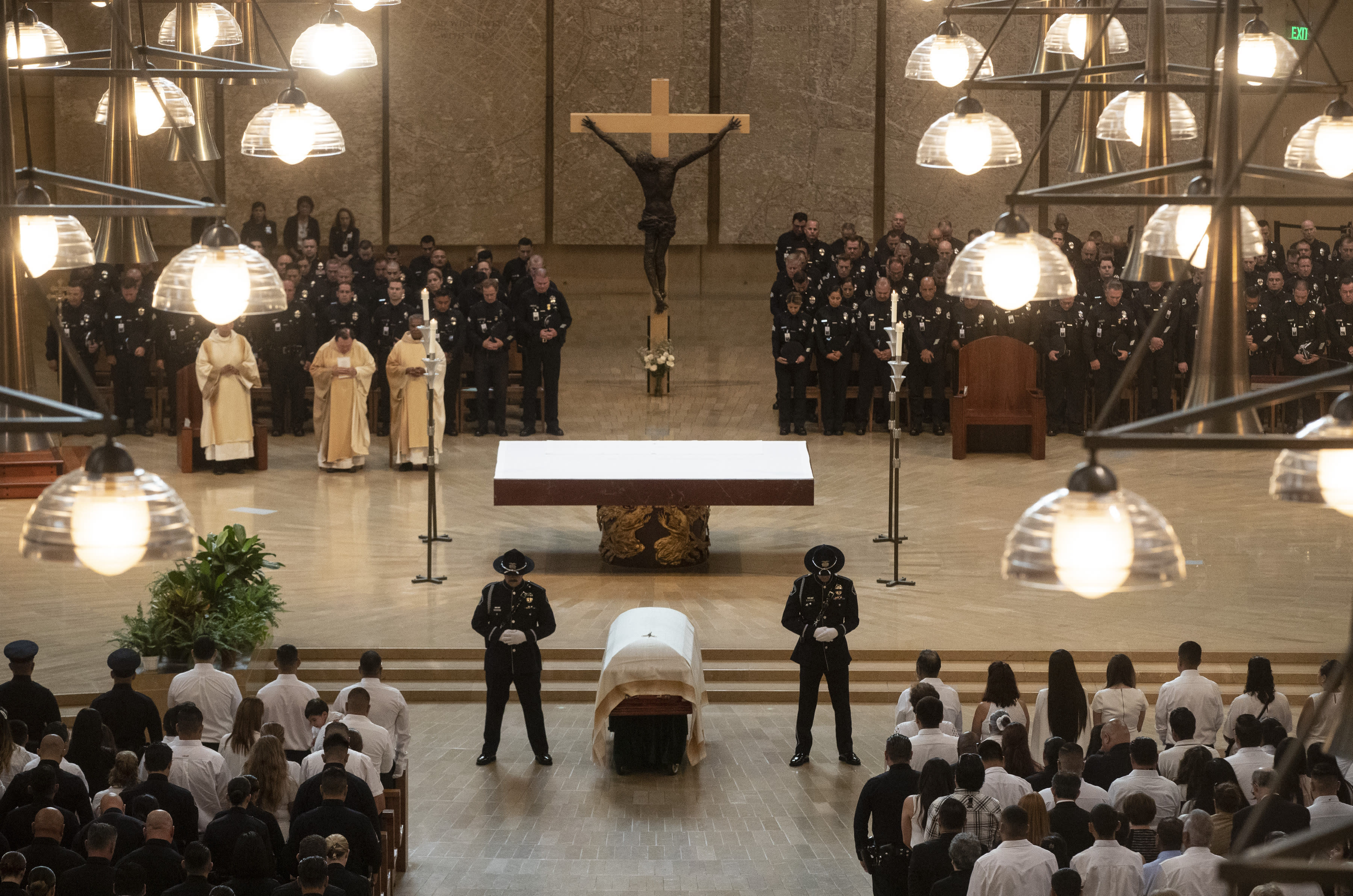 Honor guards flank Juan Diaz's casket during funeral mass for the slain LAPD officer at the Cathedral of Our Lady of the Angels in Los Angeles, Calif., on Monday, Aug. 12, 2019. (Brian van der Brug/Los Angeles Times via AP, Pool)