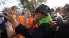 Scuffles at Thai temple as police hunt for monk
