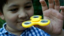 Russia probes fidget spinners over fears toys being used by anti-Putin activists to 'brainwash children'