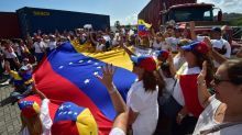 Prayers, holy water as Venezuelan Curacao aid shipment delayed