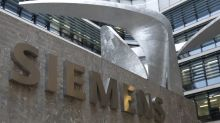 Siemens sees lower profit, but books more big-ticket orders