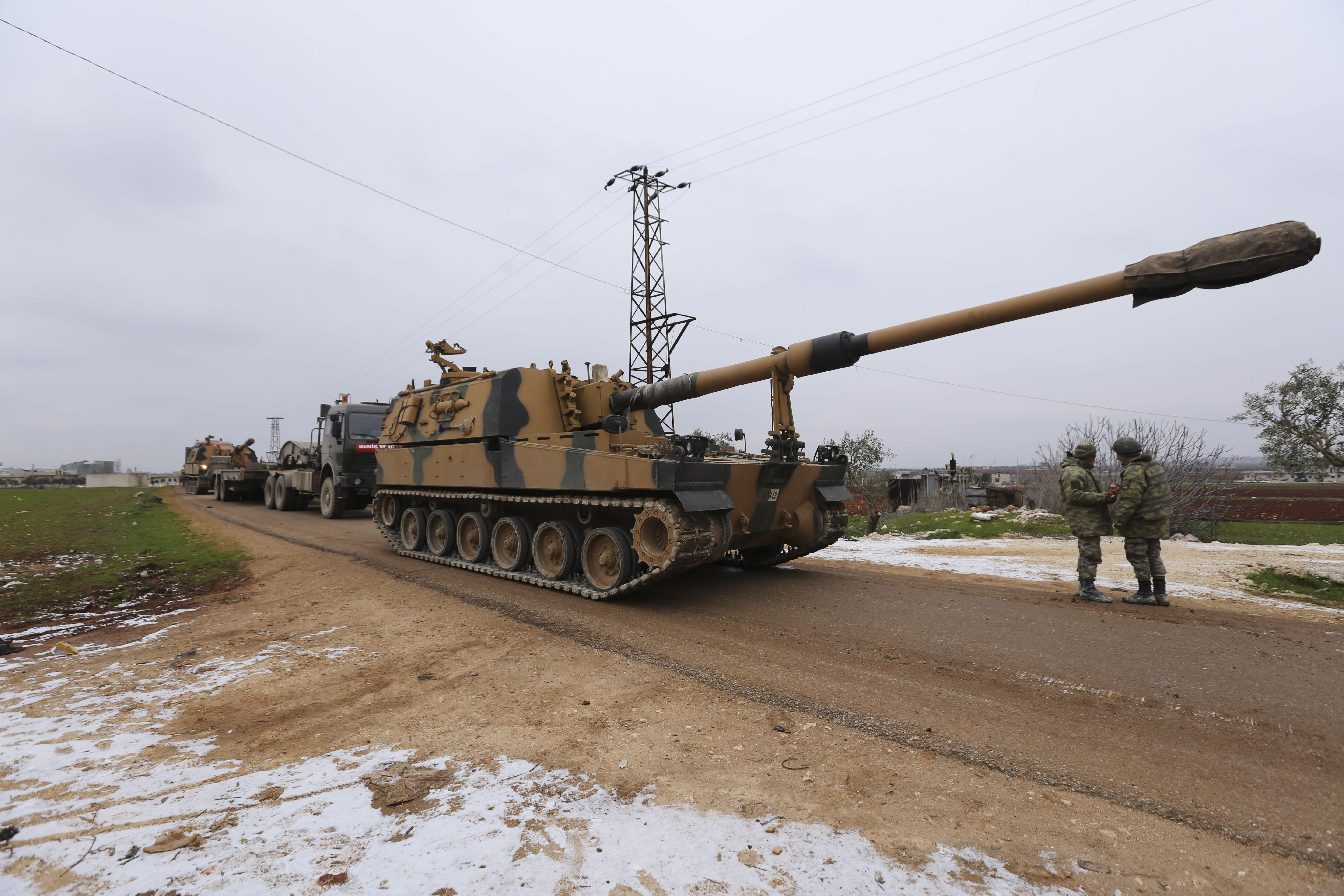 Turkish military convoy is seen near the town of Idlib, Syria, Wednesday, Feb. 12, 2020. Turkish President Recep Tayyip Erdogan said Wednesday that Turkey will attack government forces anywhere in Syria if another Turkish soldier is injured. (AP Photo/Ghaith Alsayed)