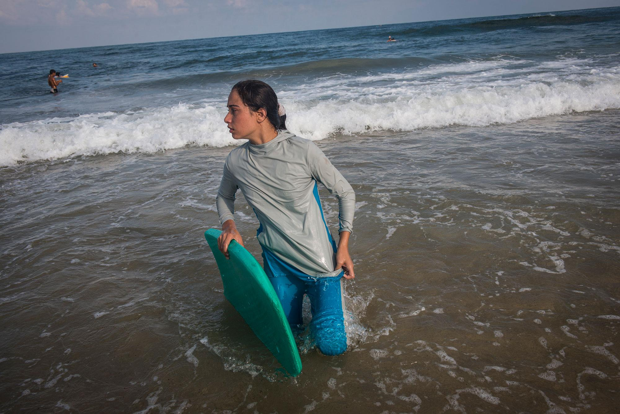 <p>For many Gazans the sea is the only place they can be without being reminded of their isolation. Female Surfer, Sabah Abu Ghanem ,14 and her sister surf early in the morning outside of Gaza city. The sisters place first in many competitions inside the strip, but have never left the Gaza Strip to compete. (Photograph by Monique Jaques) </p>