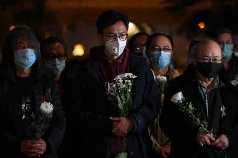 People attend a vigil in Hong Kong for dead Chinese doctor Li Wenliang, who tried to warn about the new coronavirus (AFP Photo/Anthony WALLACE)