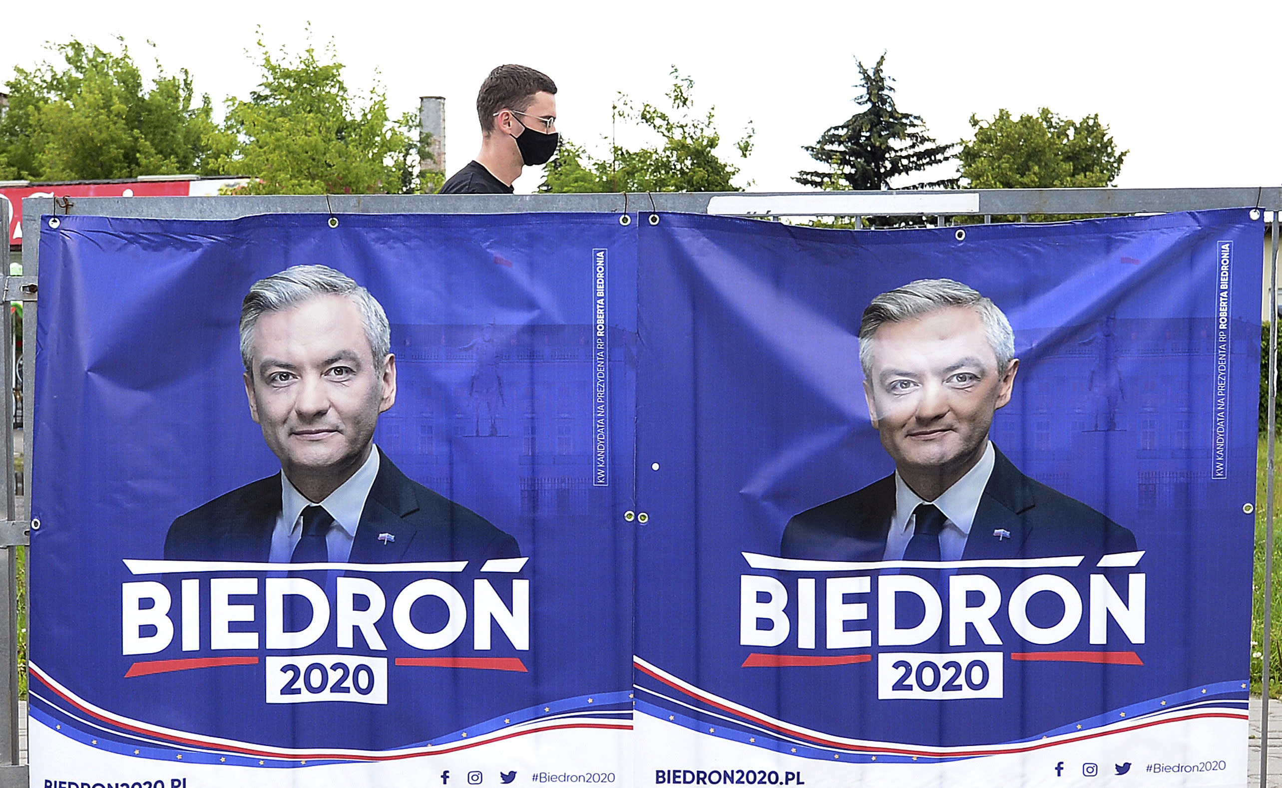 An electoral poster for left-wing candidate Robert Biedron is seen, in Warsaw, Poland, Tuesday, June 23, 2020. Biedron, who is openly gay, is currently at below 10% in the polls for Sunday's presidential election. (AP Photo/Czarek Sokolowski)