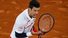 Novak Djokovic into French Open semifinals after arm problem