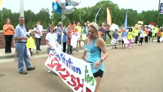 Students cheer on teacher as she finishes marathon