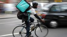 How do Deliveroo and Uber workers cope with precarious pay?