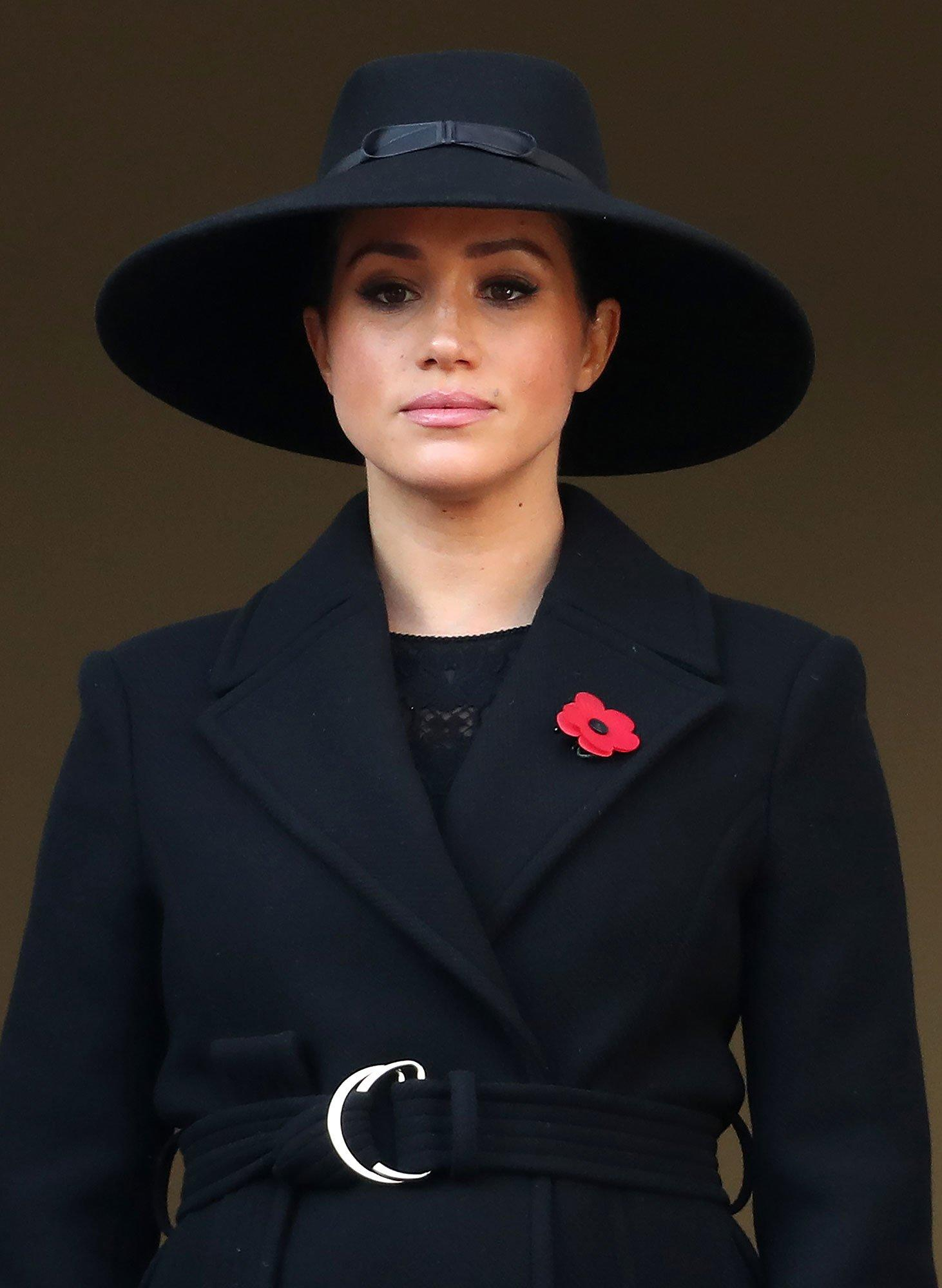 Meghan Markle Didn't Stand with the Queen, Kate & Camilla at Remembrance Ceremony — Here's Why - Yahoo Entertainment