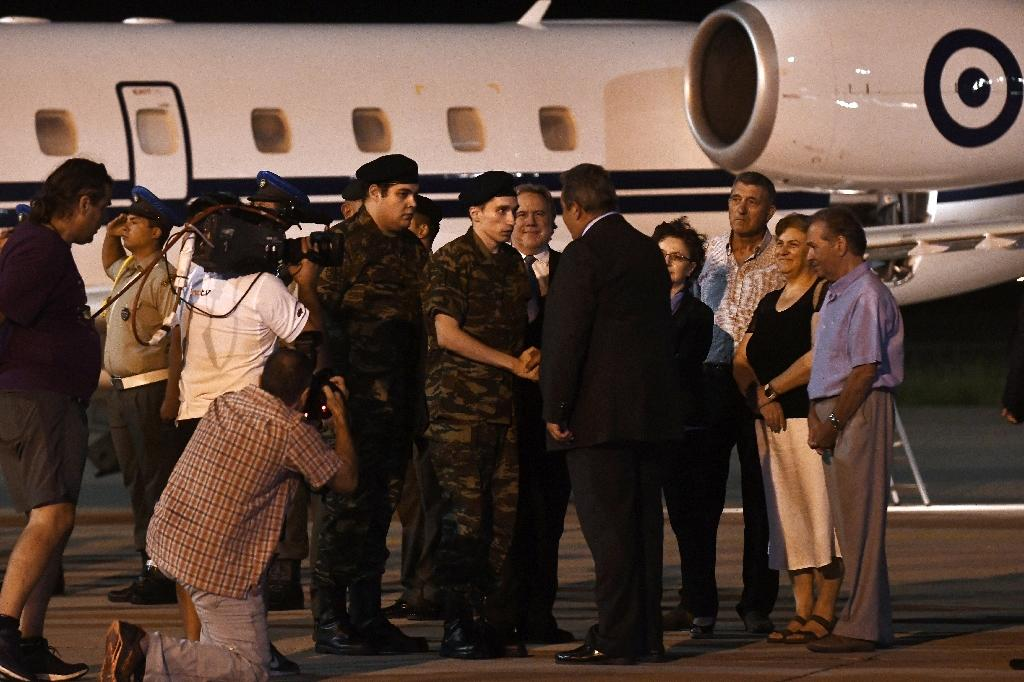 Greek Minister of Defence Panos Kammenos greeted the two soldiers on arrival back home
