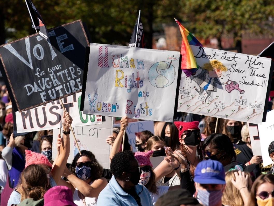 Protestors rally during the Women's March at Freedom Plaza, Saturday, Oct. 17 in Washington.